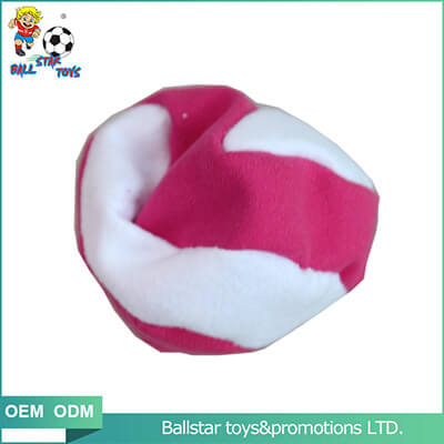 white and pink footbag juggling
